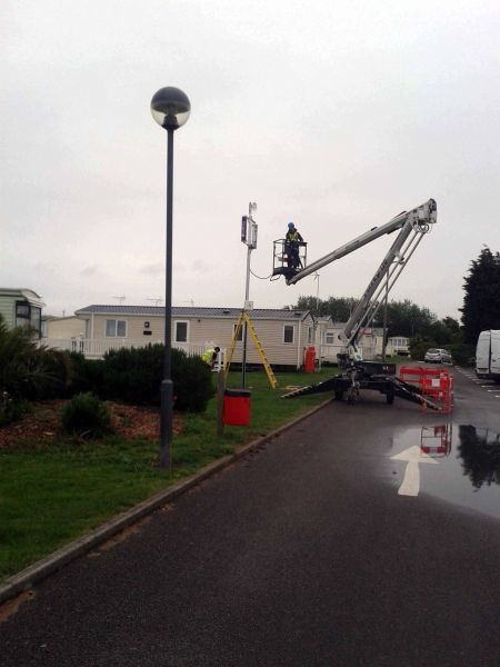 MEWP cherry picker during Wi-Fi pole installation: Swipe To View More Images