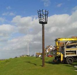 Installation of wooden pole for a fire beacon used during the Queen's 90th birthday celebrations.: Click Here To View Larger Image